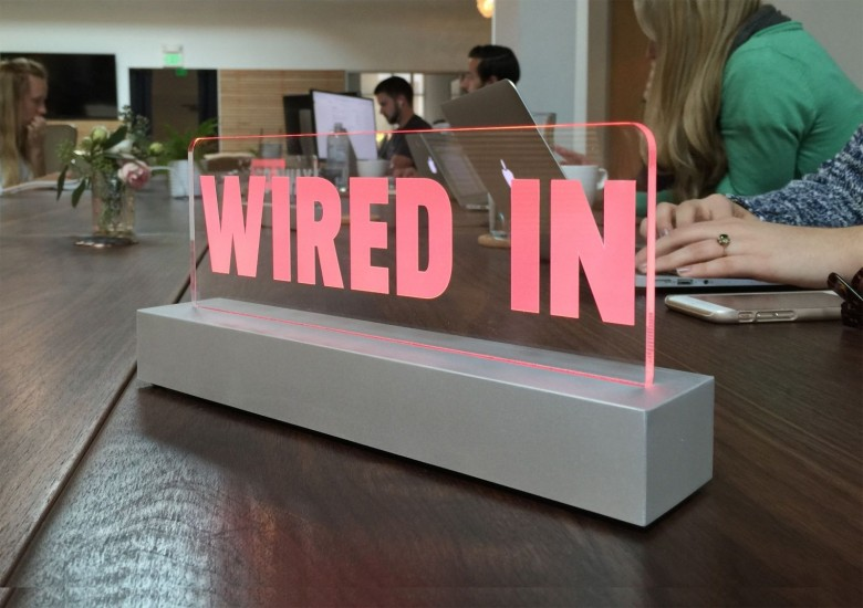 A Wired In sign for the desk can let co-workers know you can not be disturbed.