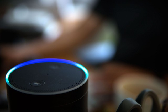 The Amazon Echo lights up when it recognizes you are making a request.