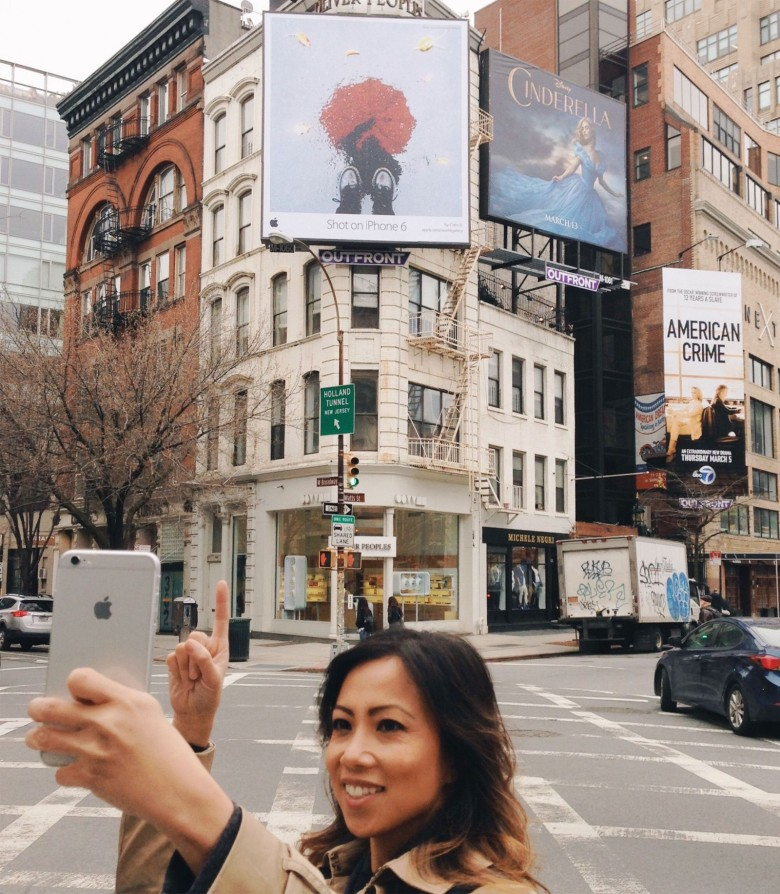 "Cielo de la Paz with her ""Shot on iPhone 6"" billboard in New York in April."