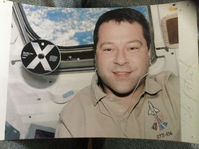 A photo from MacAbbott's Mac Museum shows astronaut Nick Patrick aboard the space shuttle Discovery with an OS X Panther disc floating near his head.
