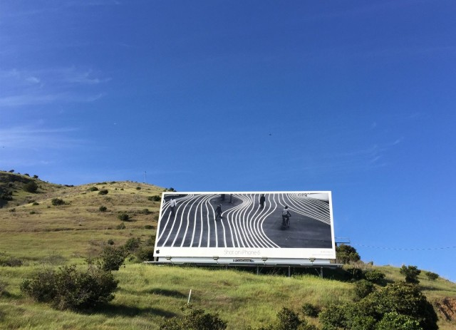 Brendan Ò Sé's photo on a billboard in California.