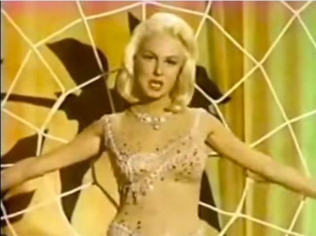 """Joi Lansing is caught in """"The Web of Love."""""""