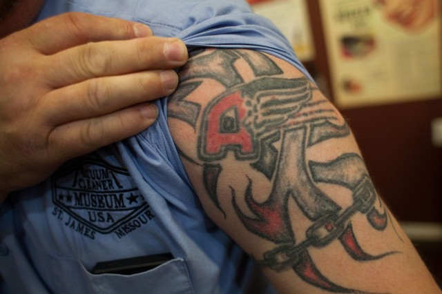 Gasko loved Air-Way vacuum cleaners and its insignia is at the center of this tattoo.