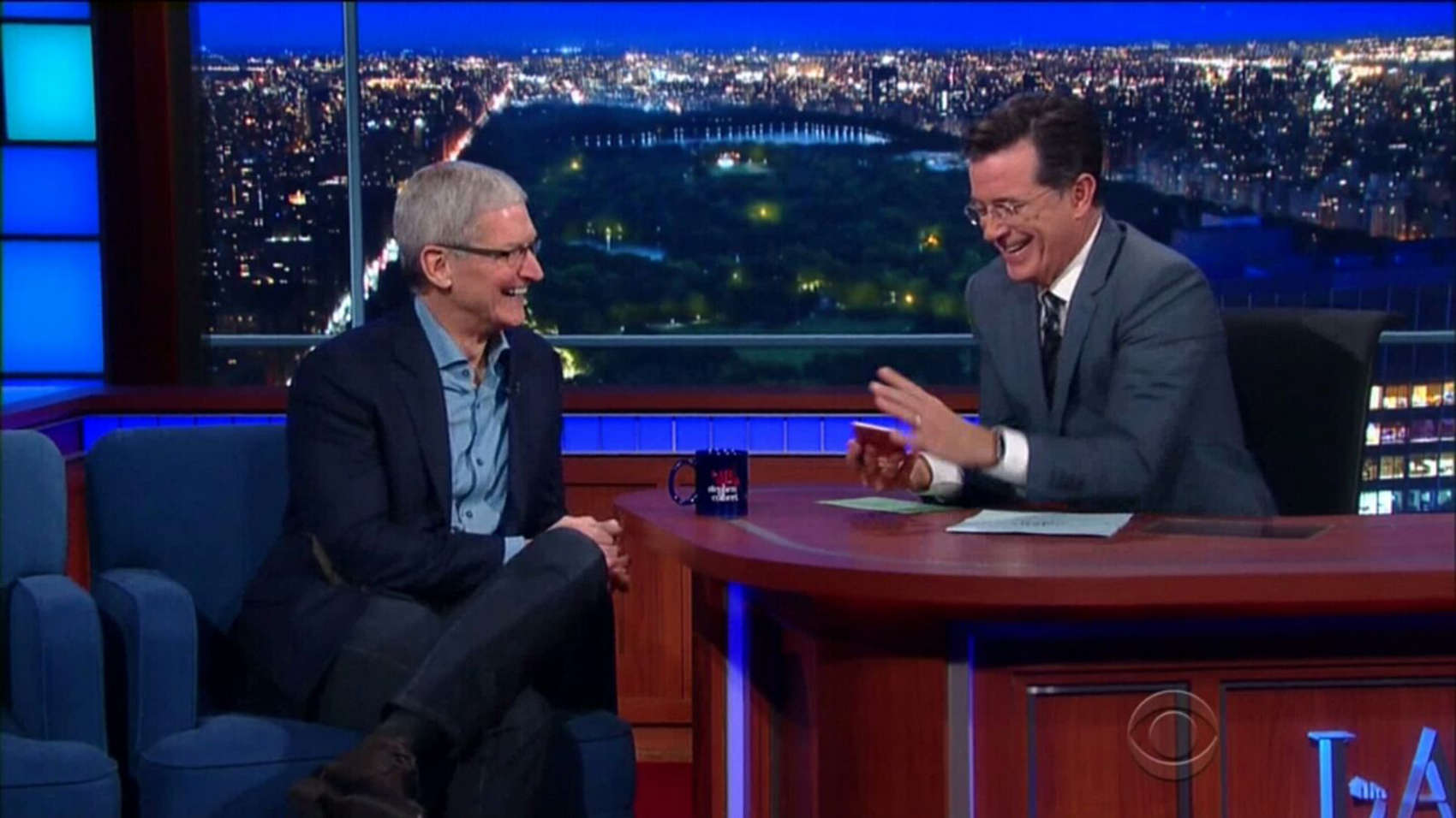 Stephen Colbert, right, with iPhones 6s in hand, jokes with Apple CEO Tim Cook.