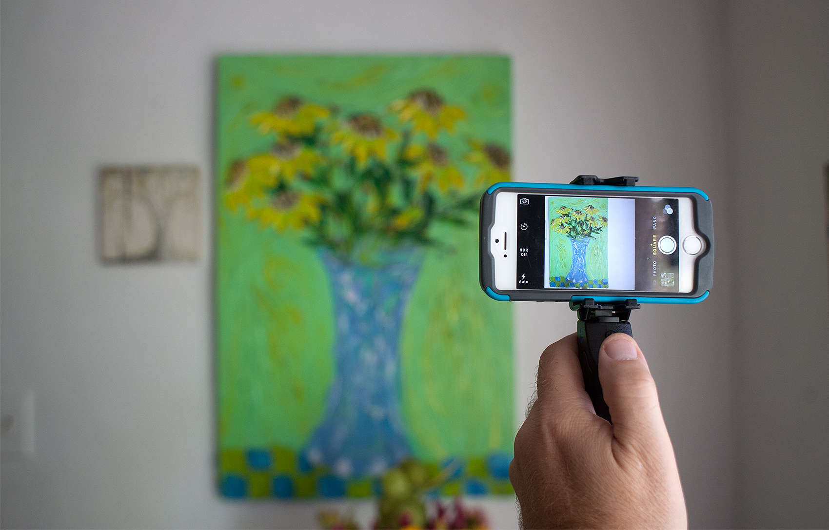 The Grip&Shoot steadies a smartphone photographer's shaky hand.