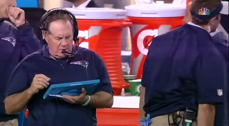 Patriots coach Bill Belichick on the sidelines with an 'iPad.'
