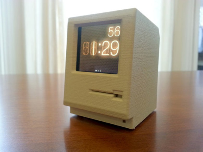 Mangin created a classic Macintosh that works as a dock for the iPod Nano.