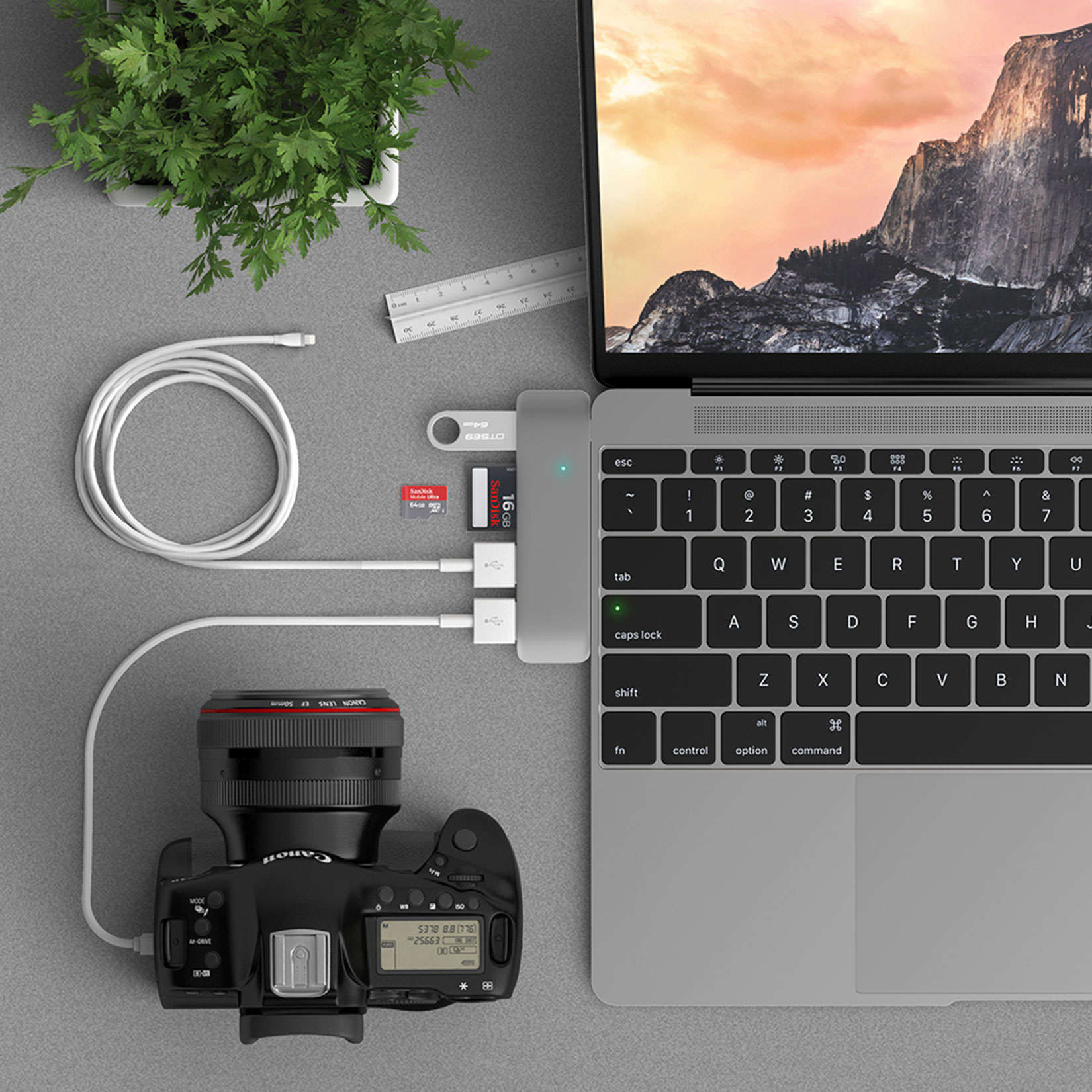 The Satechi adaptor is ideal for the new MacBook and comes in the same colors.