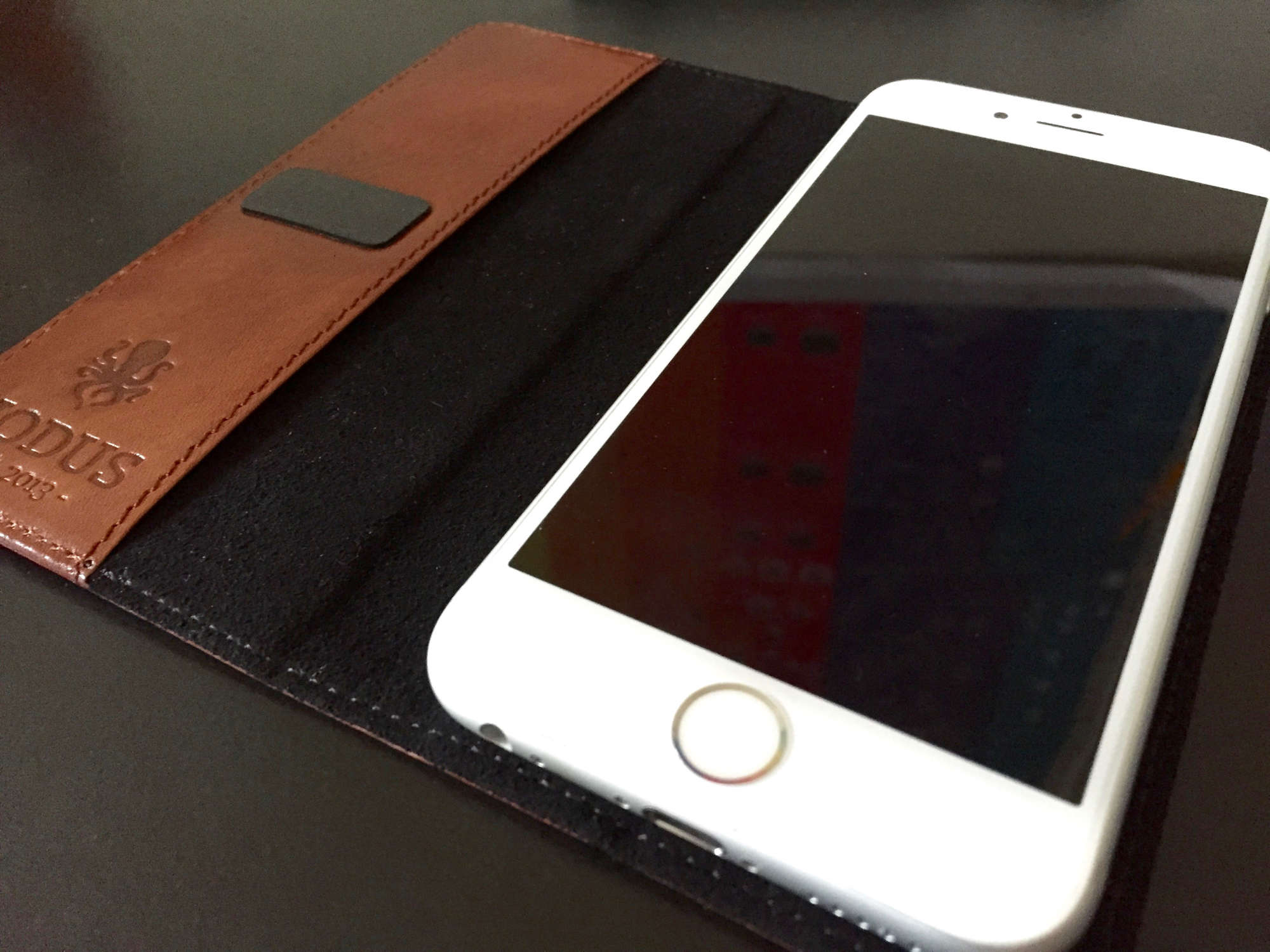 info for a132b 2ae72 Clever leather wallet case can turn iPhone 6s into a dock