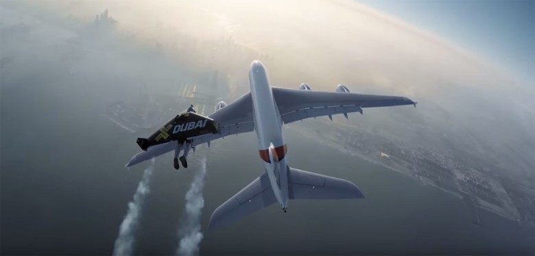 A Jetman Dubai pilot soars to catch up with an Emirates A380 commercial jet.