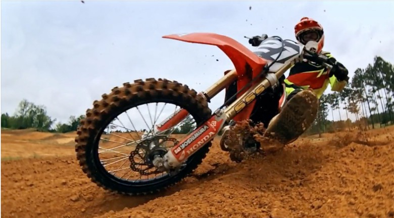 The iPhone in close at dirt level on a motocross track.