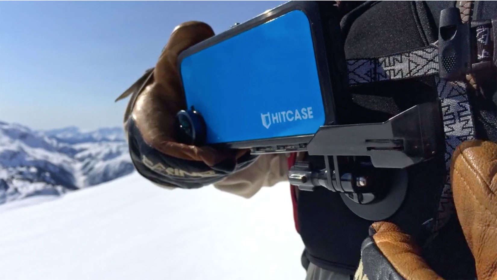 A skier used a mount to hold an iPhone 6 with a HITCASE for filming on a downhill run.