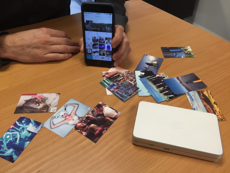 The LifePrint printer spits out small photos that can trigger videos in an app.