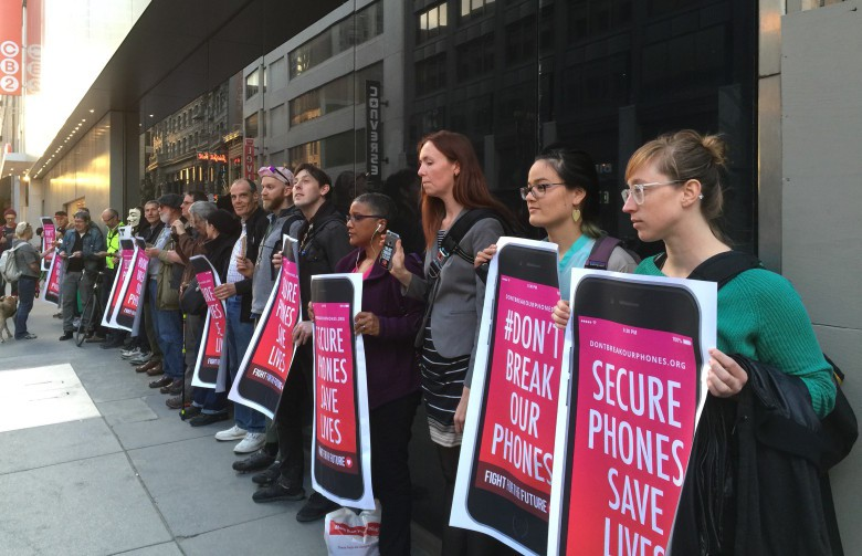 Protesters in San Francisco line up with pro-privacy signs outside the downtown Apple Store.