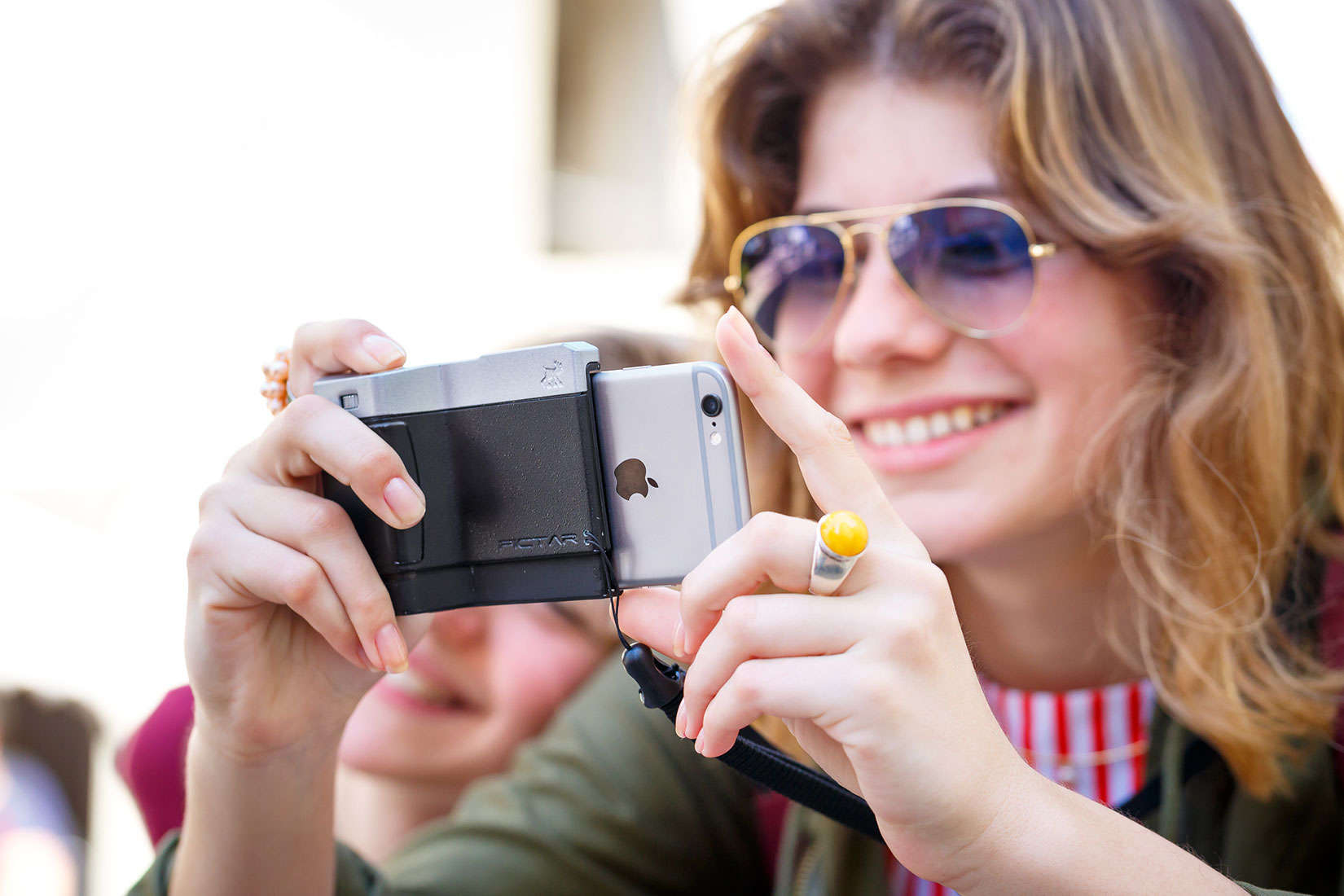 Pictar eliminates the worry of dropping your iPhone while making pictures.