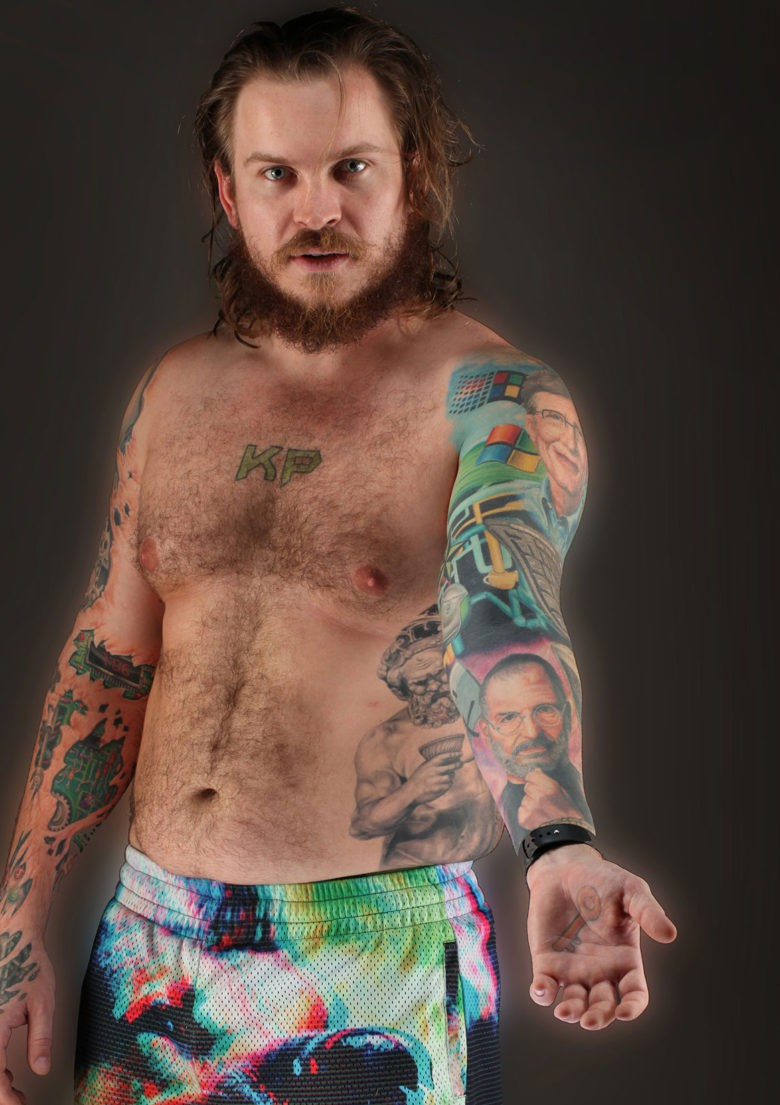 The story of technology is being painted on the body of Kenny Pollock.