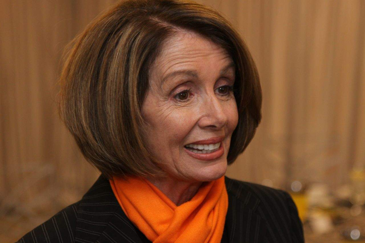 Minority Leader Nancy Pelosi is mad at Tim Cook.