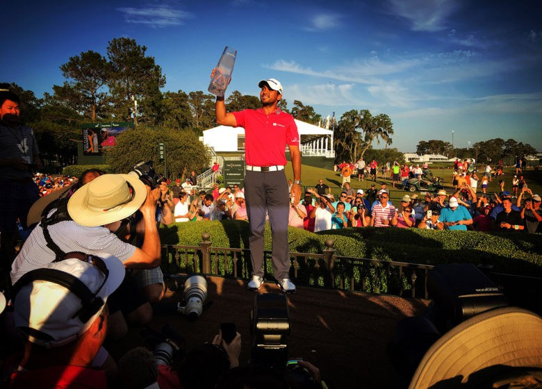 Jason Day holds up the winner's trophy after claiming THE PLAYERS Championship at TPC Sawgrass in Ponte Vedra Beach, Fla., in May.