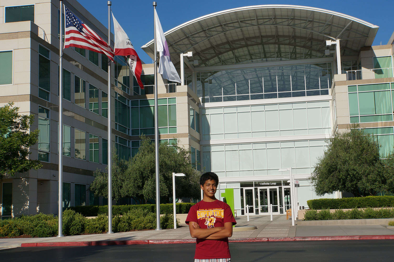 Varun Shenoy, standing outside Apple headquarters, created an app to summarize the news.