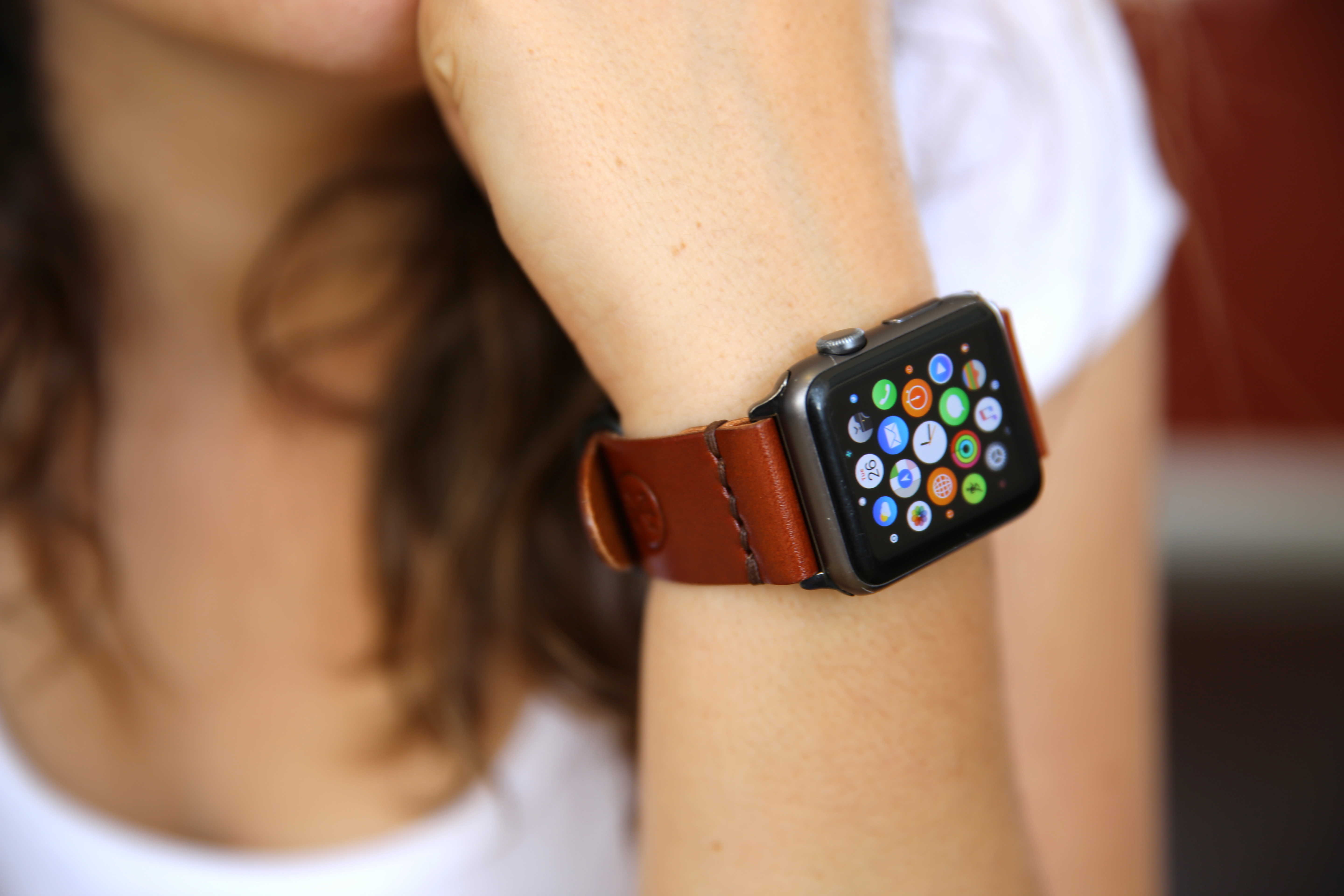 Apple Watch with brown strap
