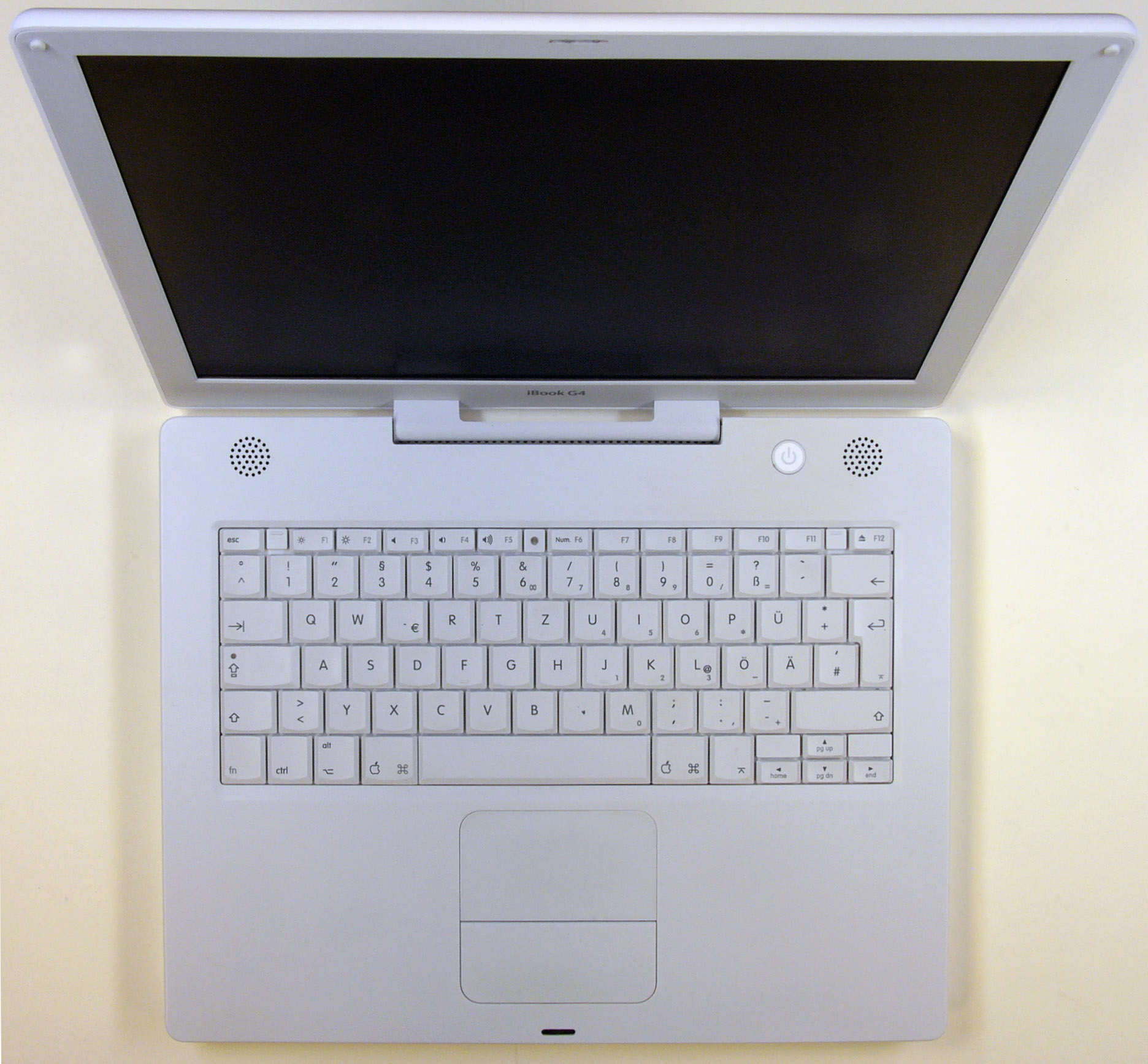 Rugged and pearly white, the iBook G4 becomes the last of its line.