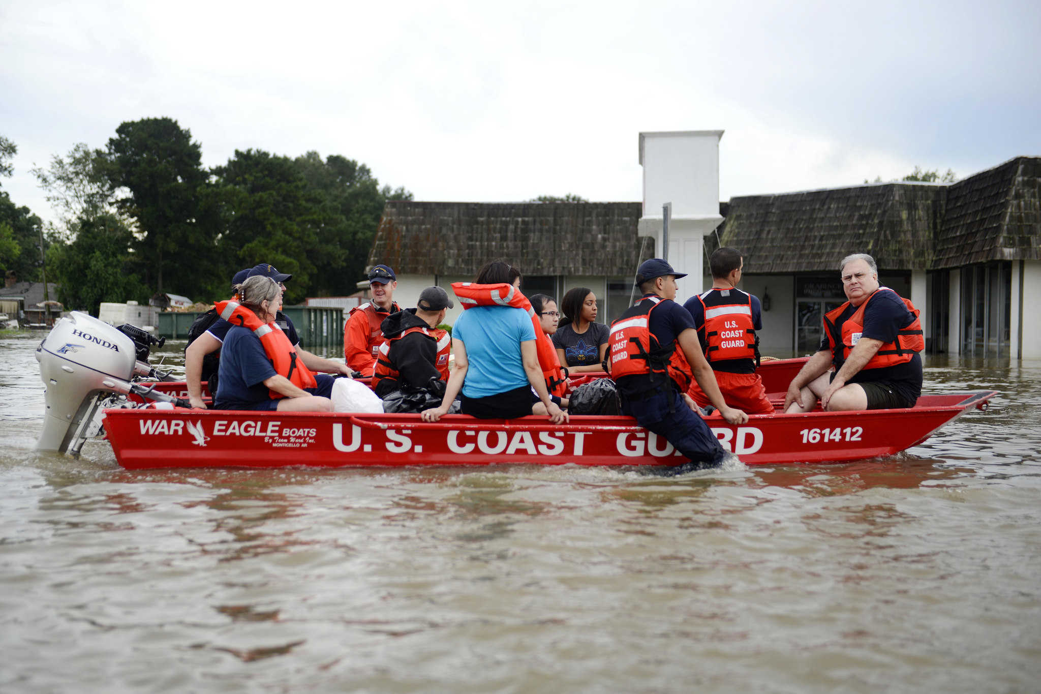 Coast Guardsmen rescue stranded residents from high water during severe flooding around Baton Rouge, Louisiana.