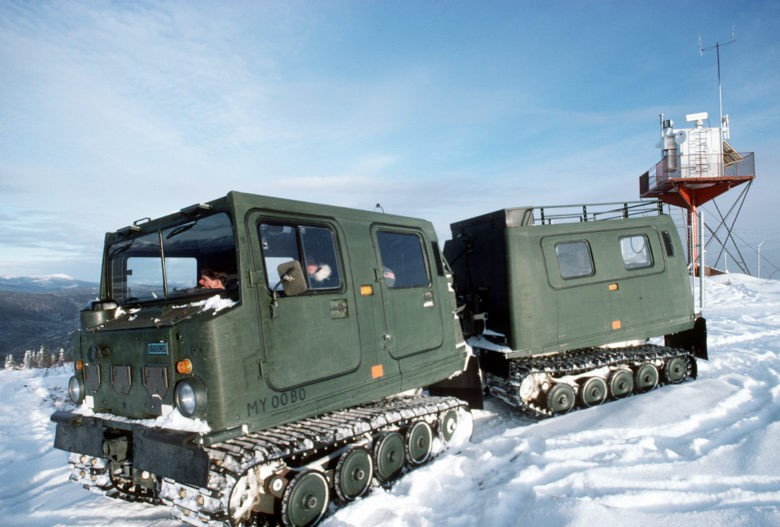 Maintenance personnel from the 5055th Range Squadron drive an M-973 small unit support vehicle through the snow.