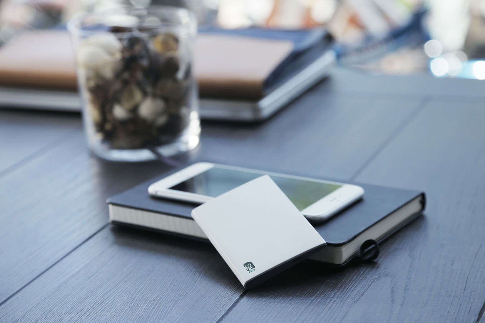 Carry an extra iPhone or carry a SIMpro to manage that extra phone line.