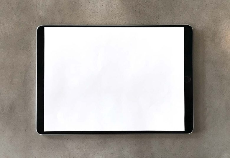 A 10.5-inch piece of paper on a 9.7-inch iPad Pro.