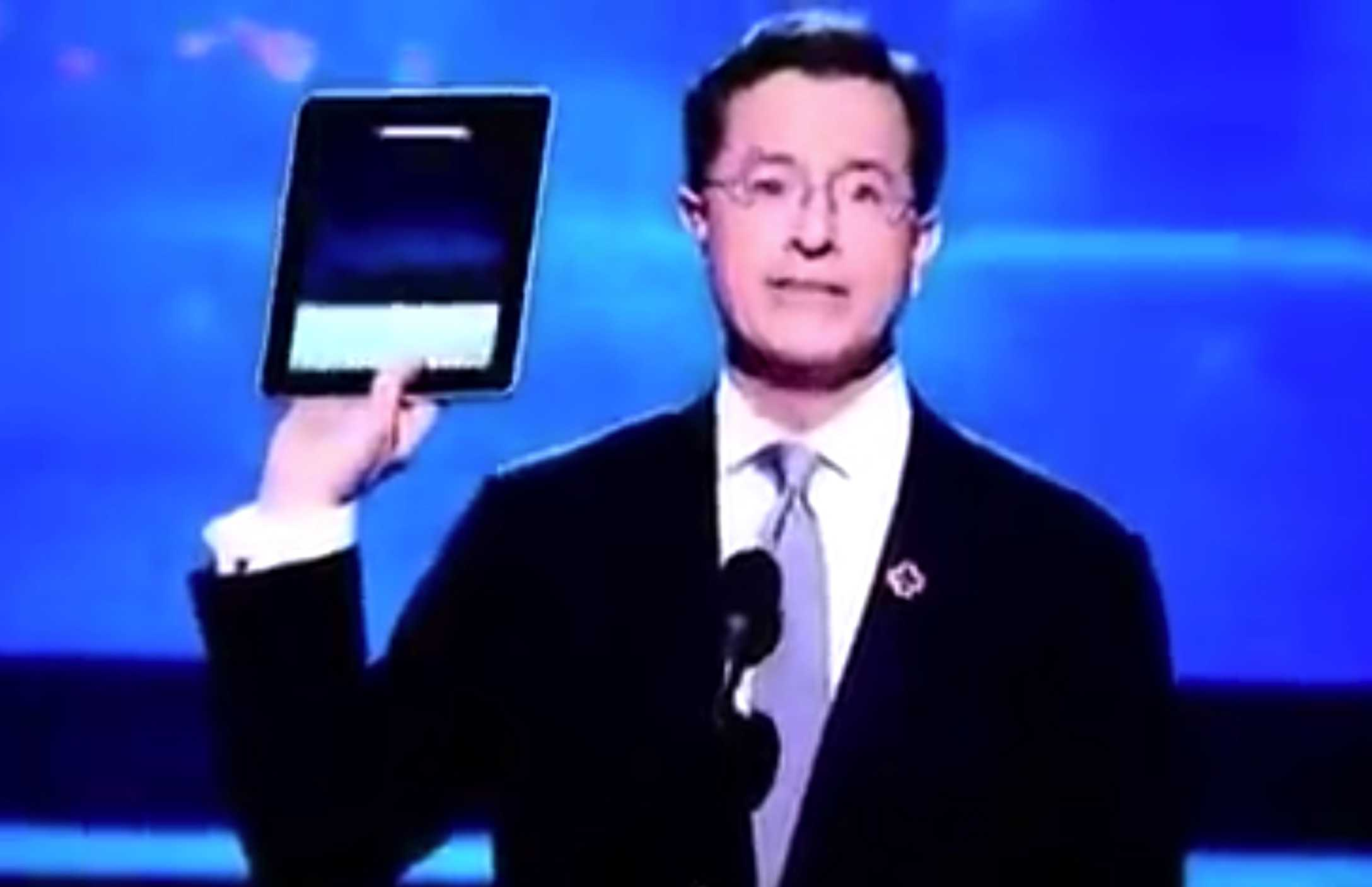 Stephen Colbert shows off a prerelease iPad during the Grammy Awards show.
