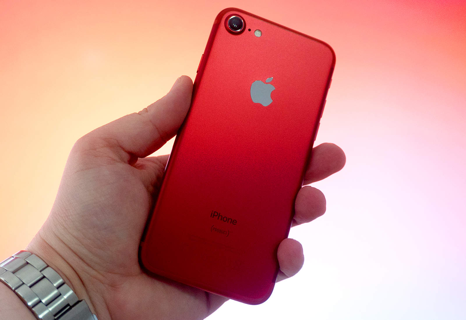 Red iPhone in hand