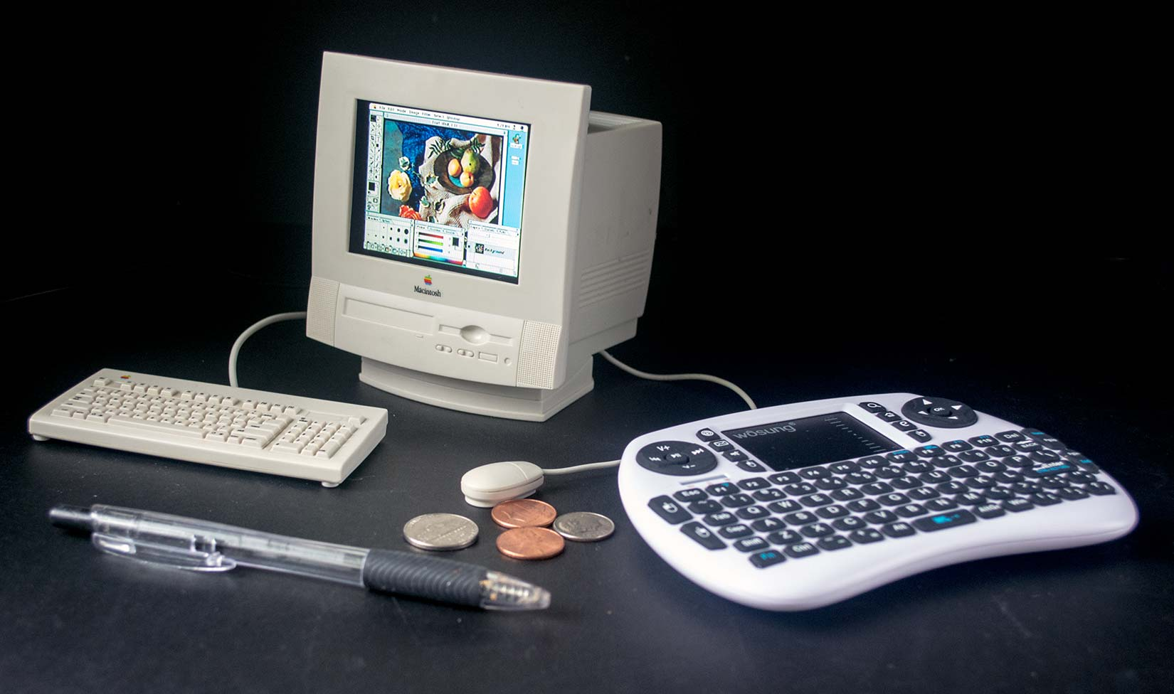 This tiny toy Mac runs Photoshop for work on tiny pictures.