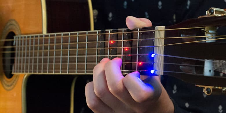 Boring old guitar lessons get a high tech upgrade with this mobile-connected training device.