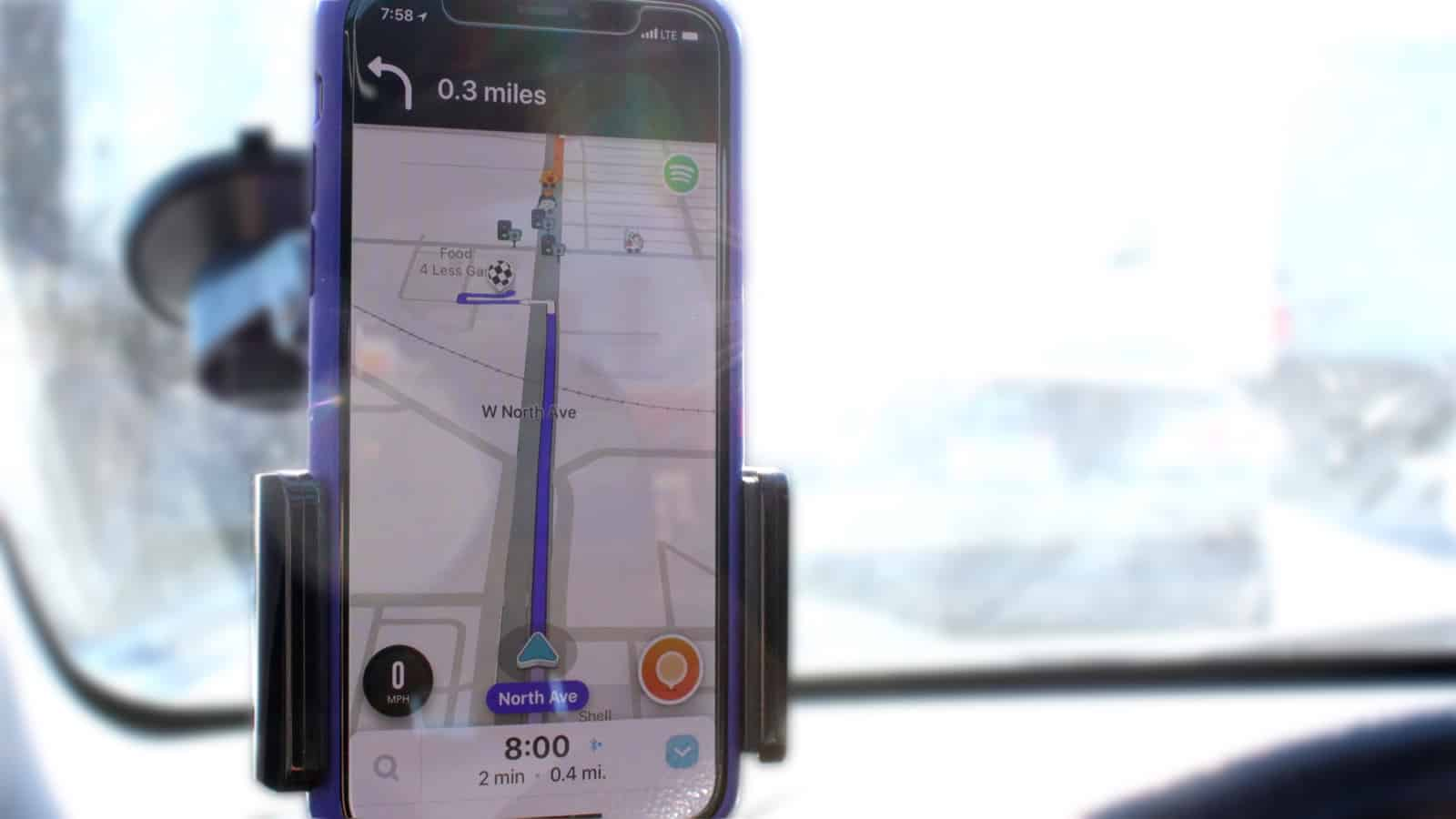 Waze on iPhone in a car GPS mount