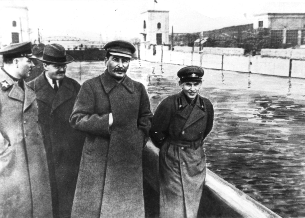 Here's a photo of Stalin and Nikolai Yezhov. Let's see if we can do better than the Soviet dictator's photo retouchers.