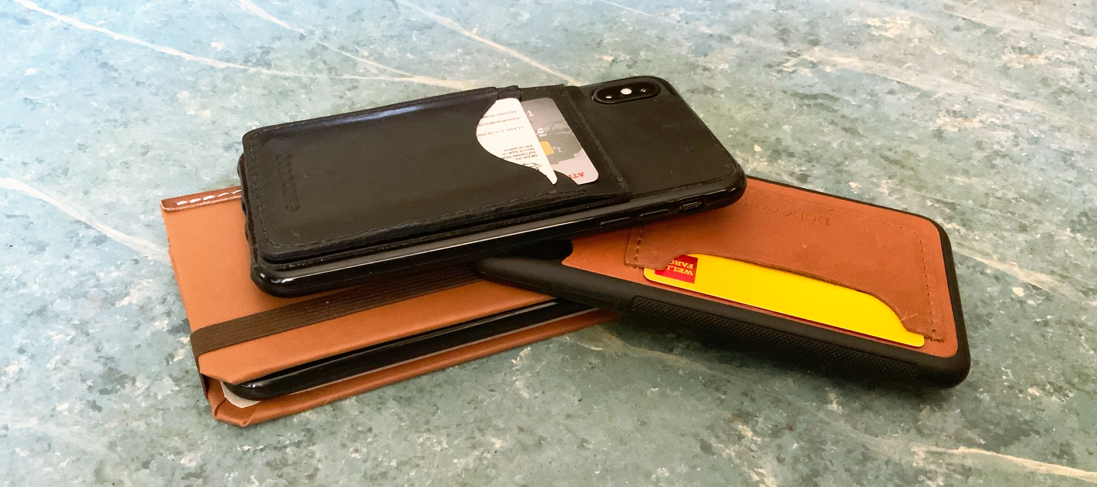 Any of these Dodocases can hold your iPhone and your credit cards, driver license, etc.
