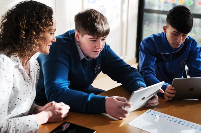 Apple volunteers teach coding at a disadvantaged high school in Ireland.