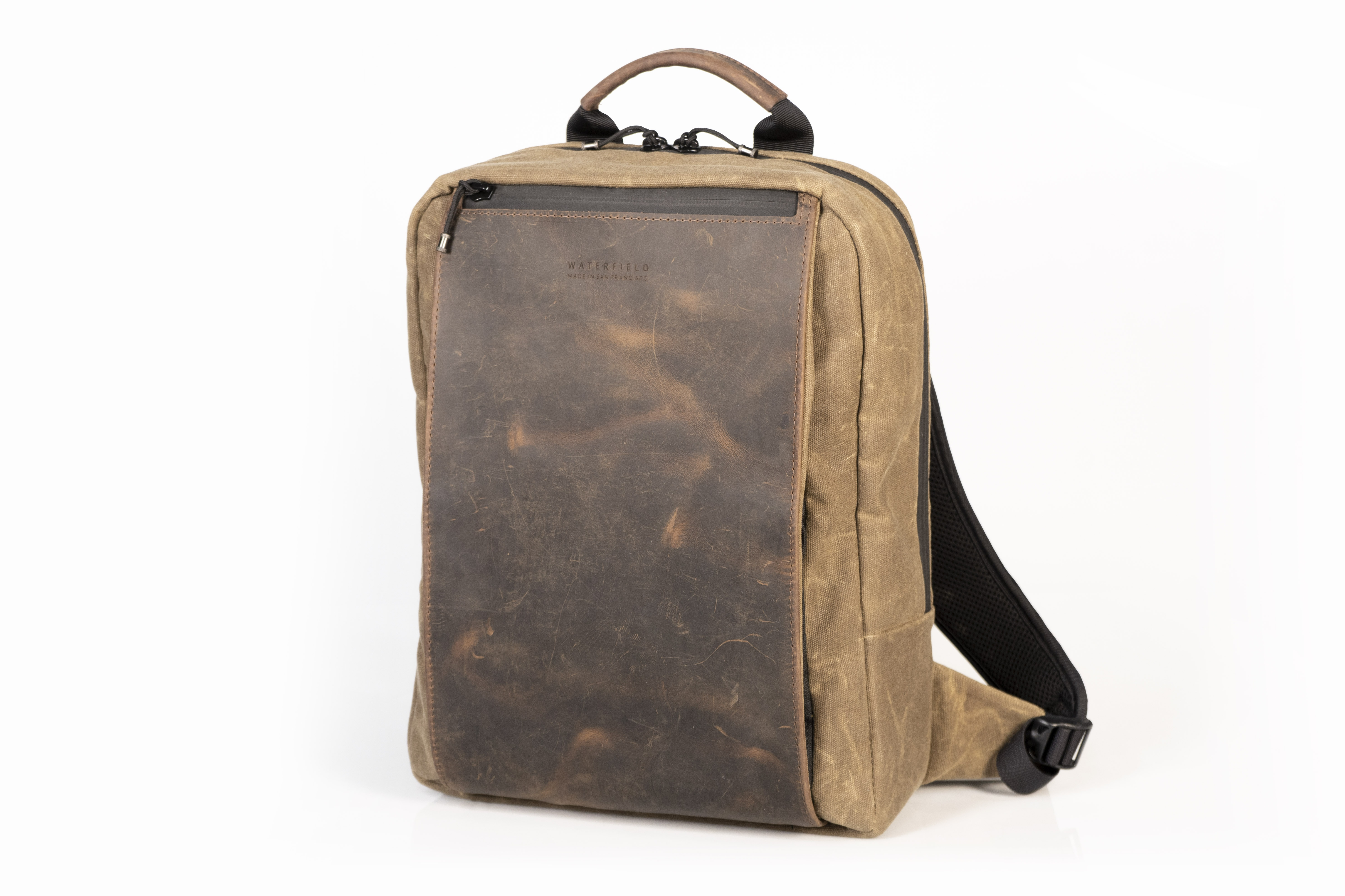 The WaterField Designs Sutter Slim Backpack in tan waxed canvas with chocolate leather accents looks classy.