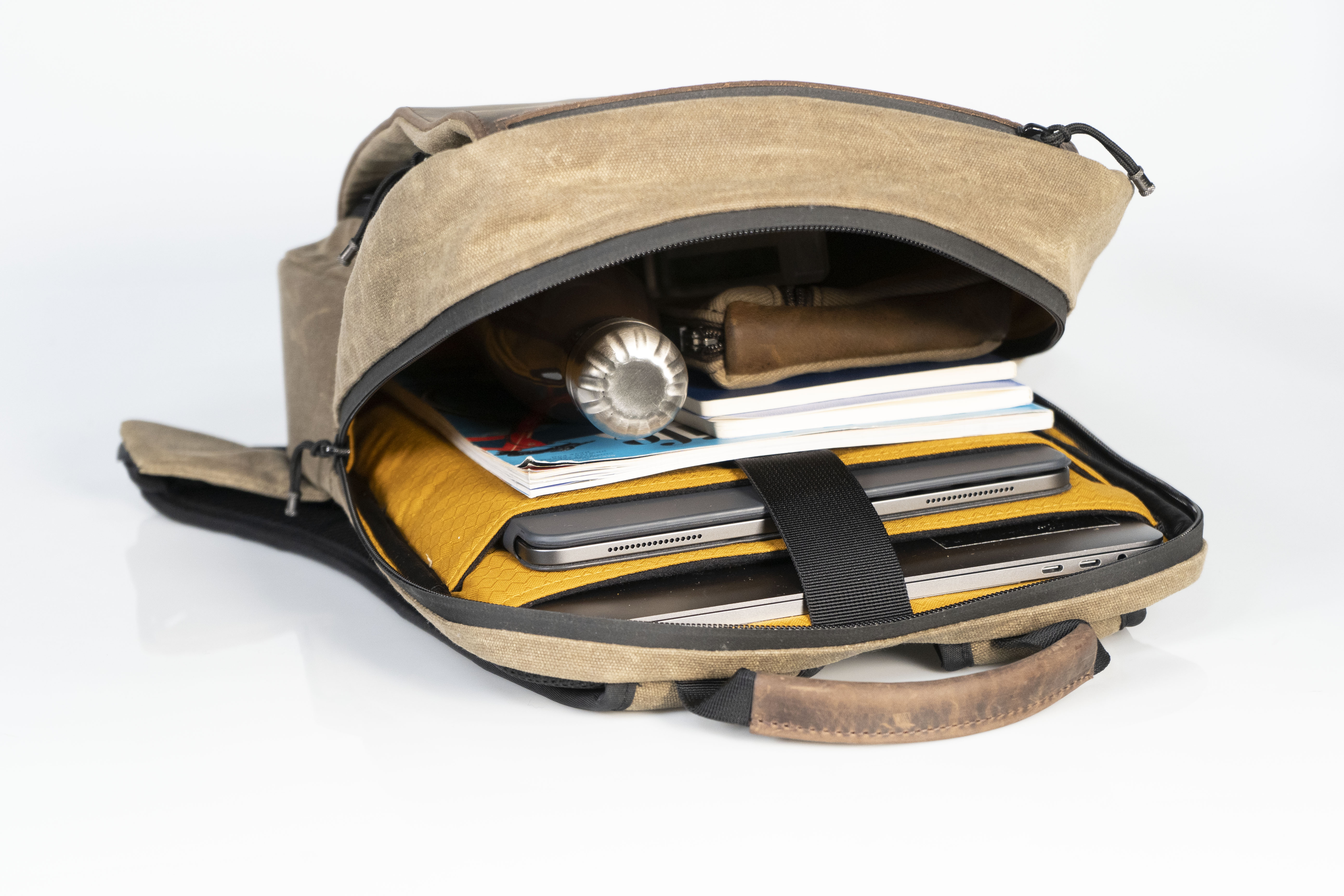 caf4c15c898 Slim backpack hides even the biggest MacBooks and iPads in style ...