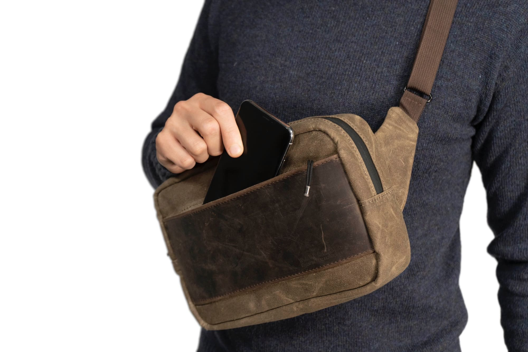 There's even a spot in the WaterField Sutter Sling Pouch for your iPhone.