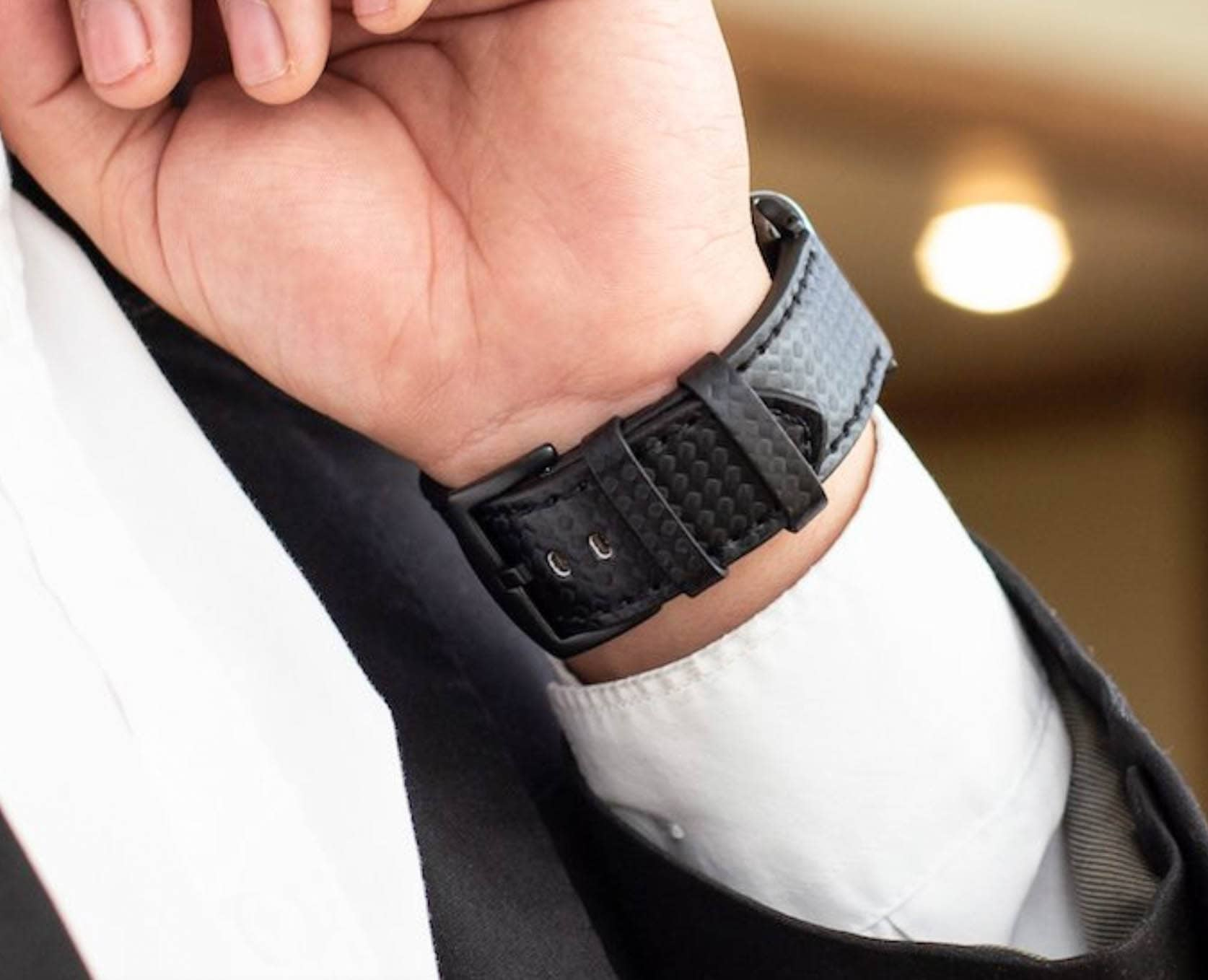 Dress like a boss without breaking the bank. Get Carterjett's modern print embossed leather Apple Watch band.