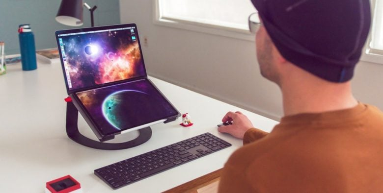 Put an iPad with Luna Display over a MacBook's keyboard to make a dual-screen laptop.