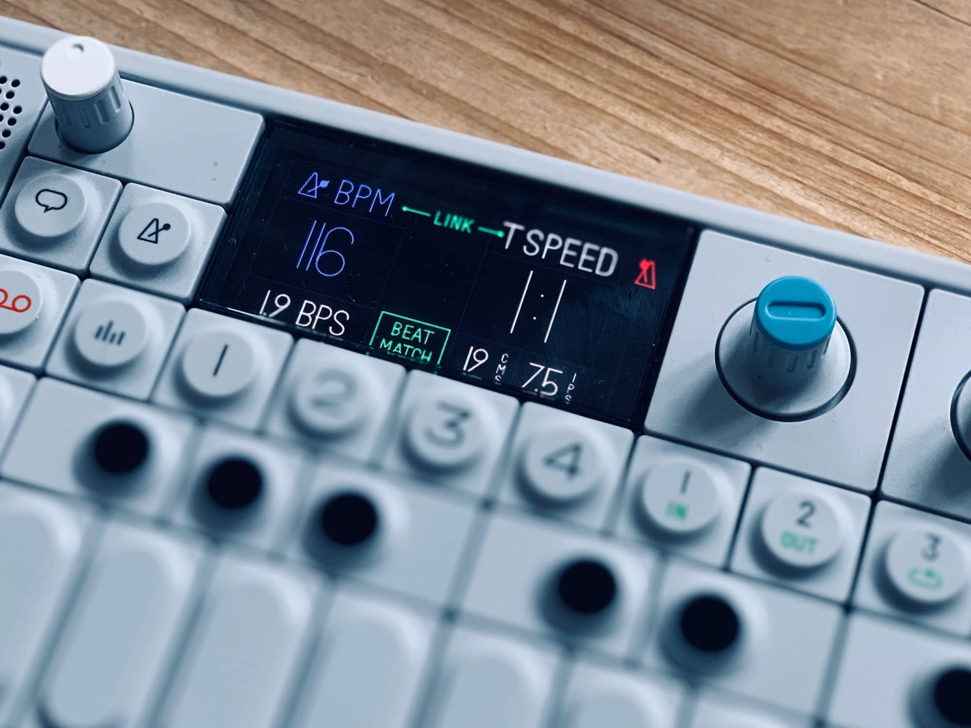 In the OP-1's metronome screen, twist the green knob until you see BEAT MATCH and LINK.
