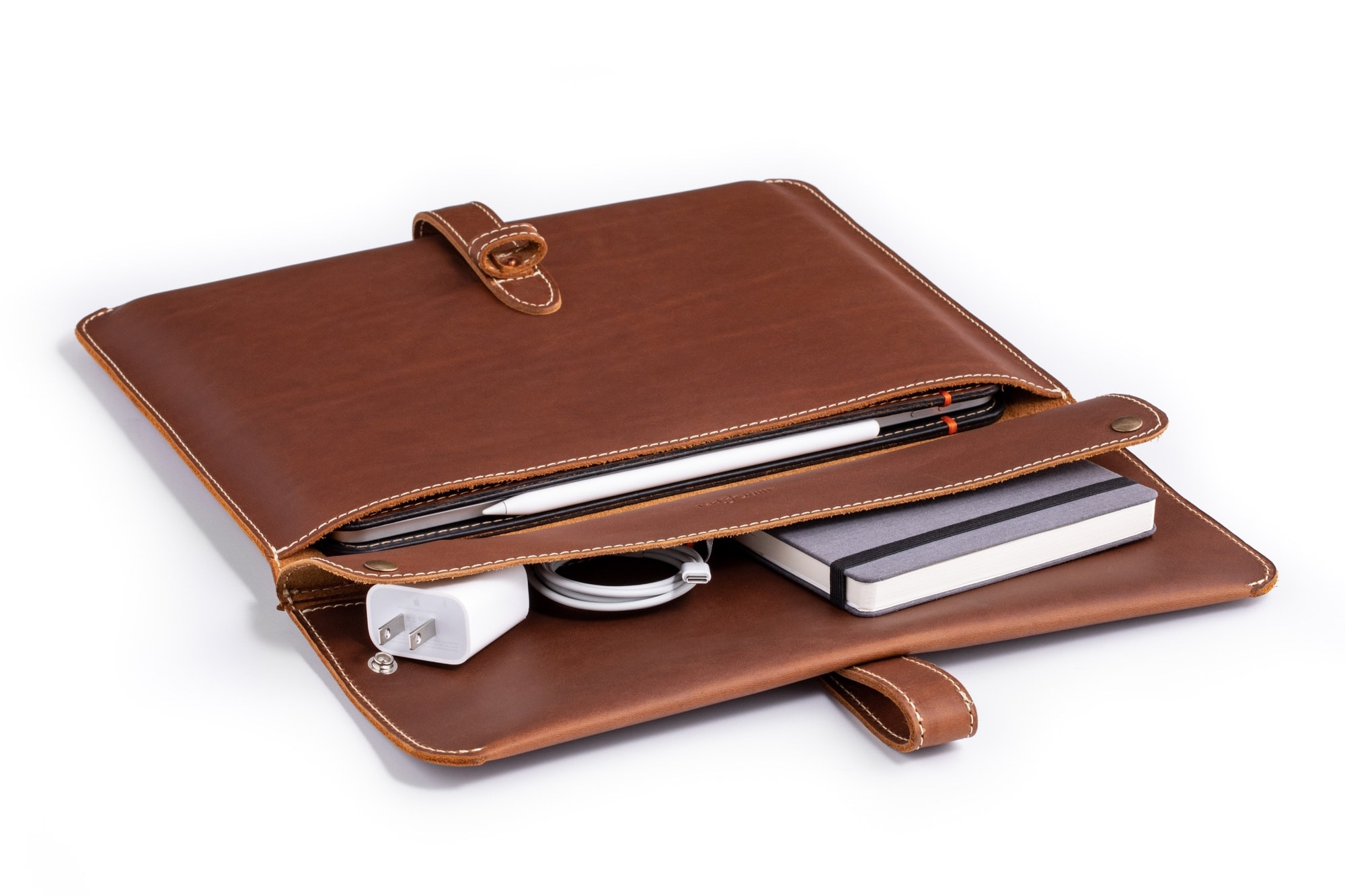 Both the main section and the pocket remain accessible when the Oxford iPad Sleeve sits flat on the desk.