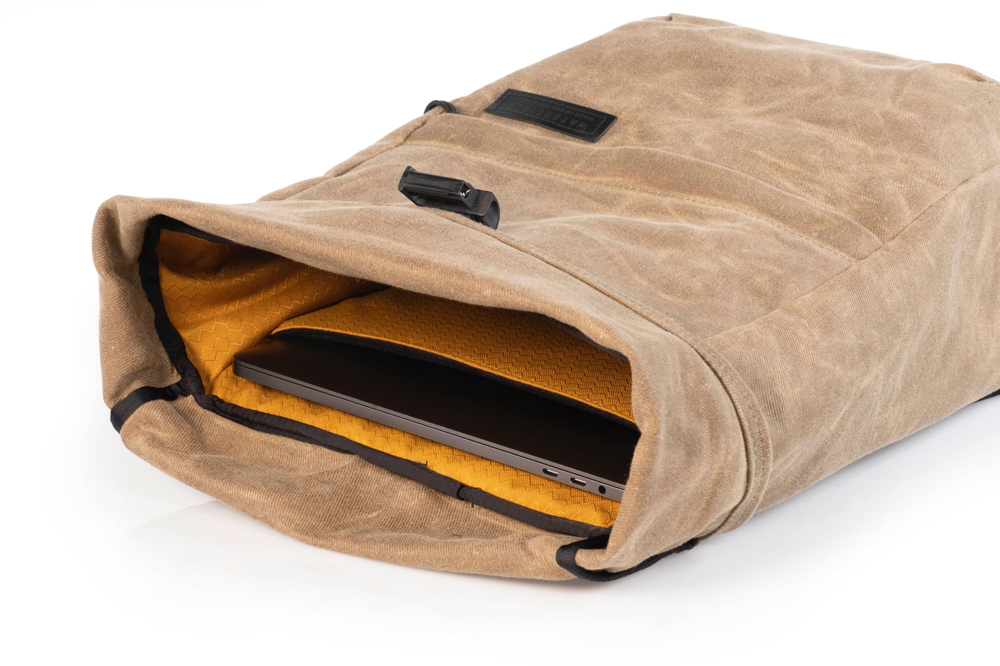 The Tech Rolltop has an internal tablet pocket, and WaterField Designs fantastic gold-colored lining.
