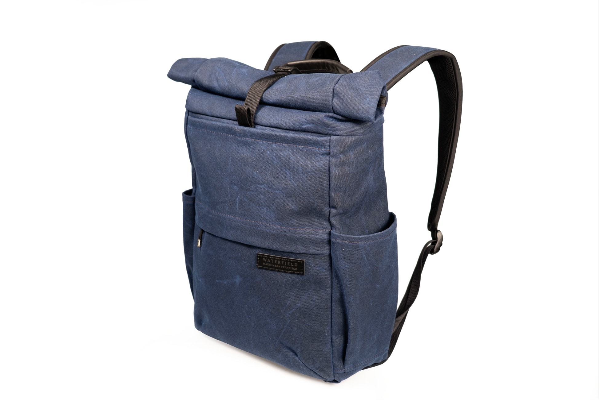 I like the blue waxed canvas version of the WaterField Tech Rolltop.