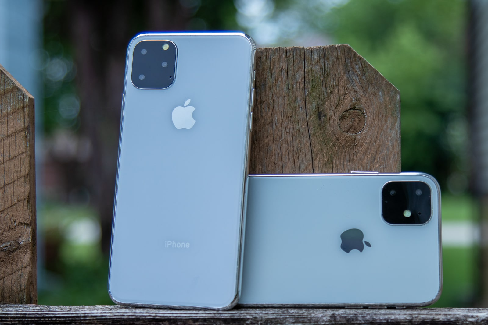 iPhone 11 R and 11 Max on fence post