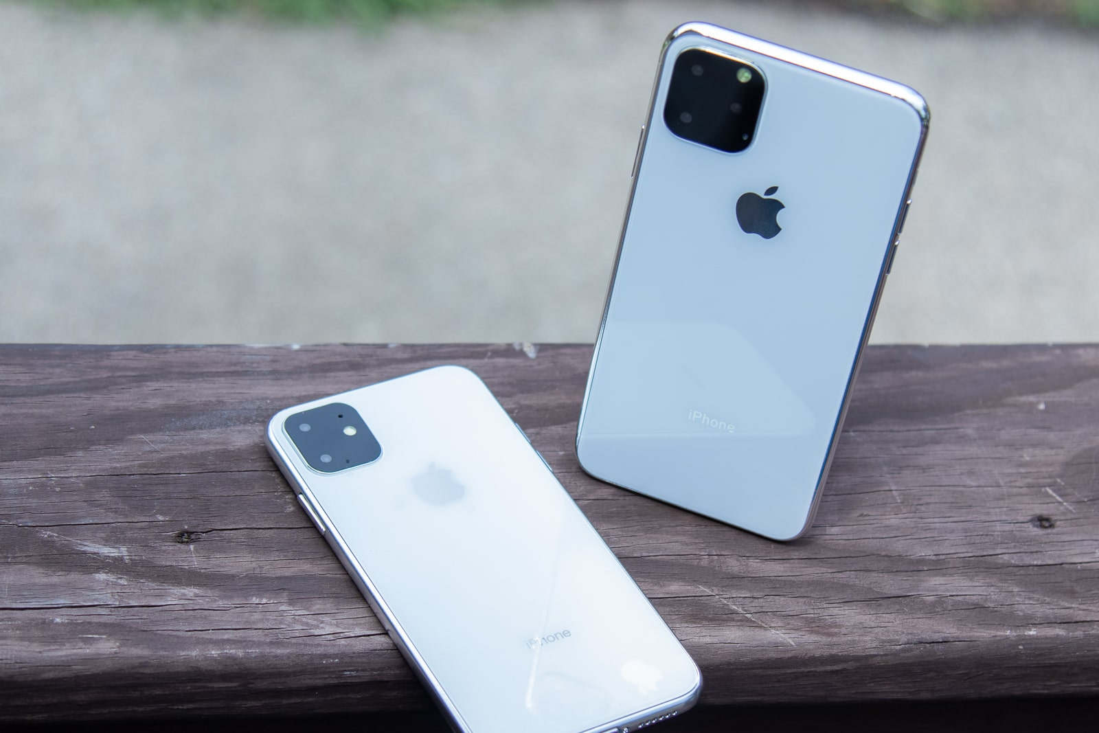 iPhone 11R and 11 Max on wooden railing
