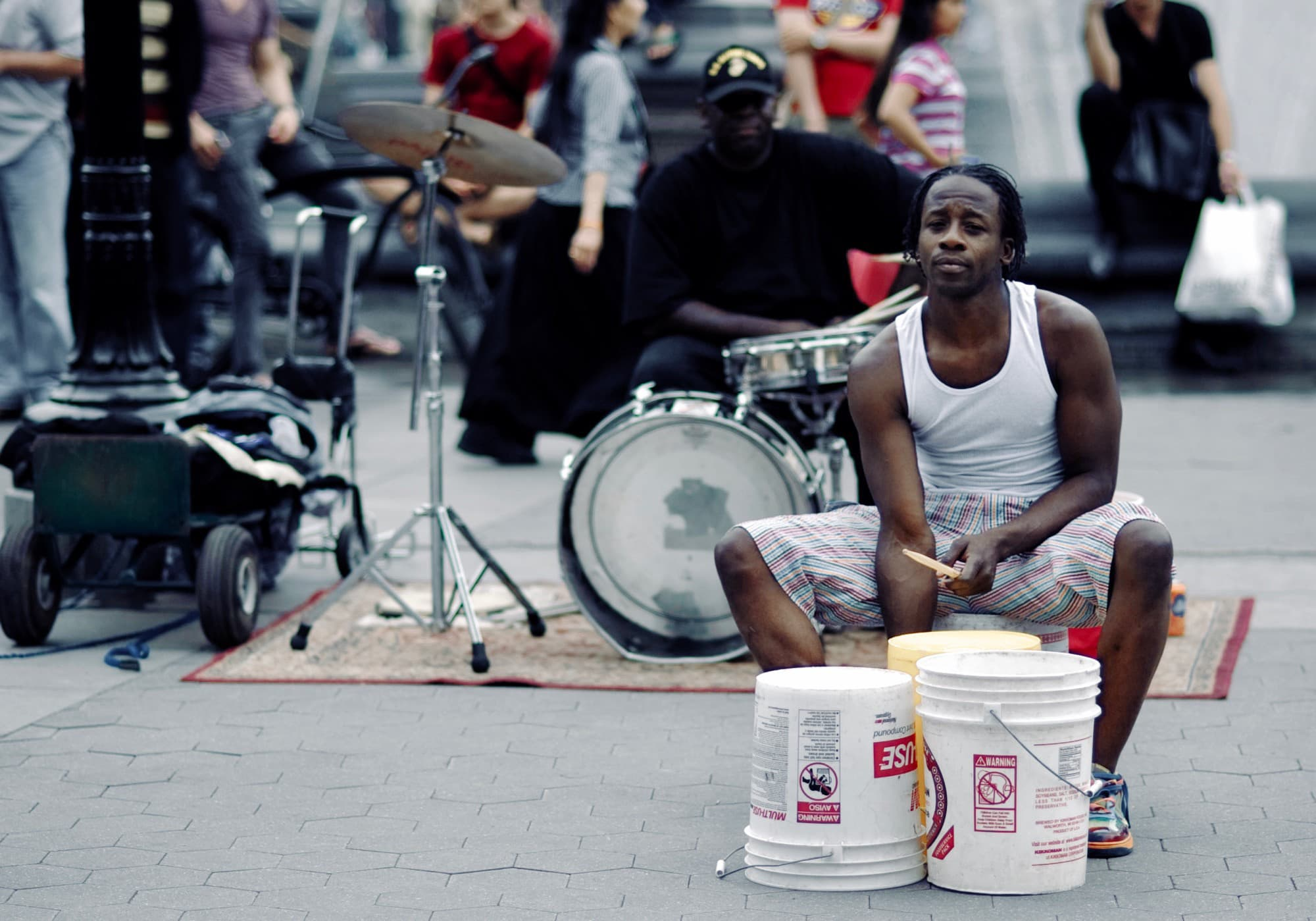 Street drummer with buckets