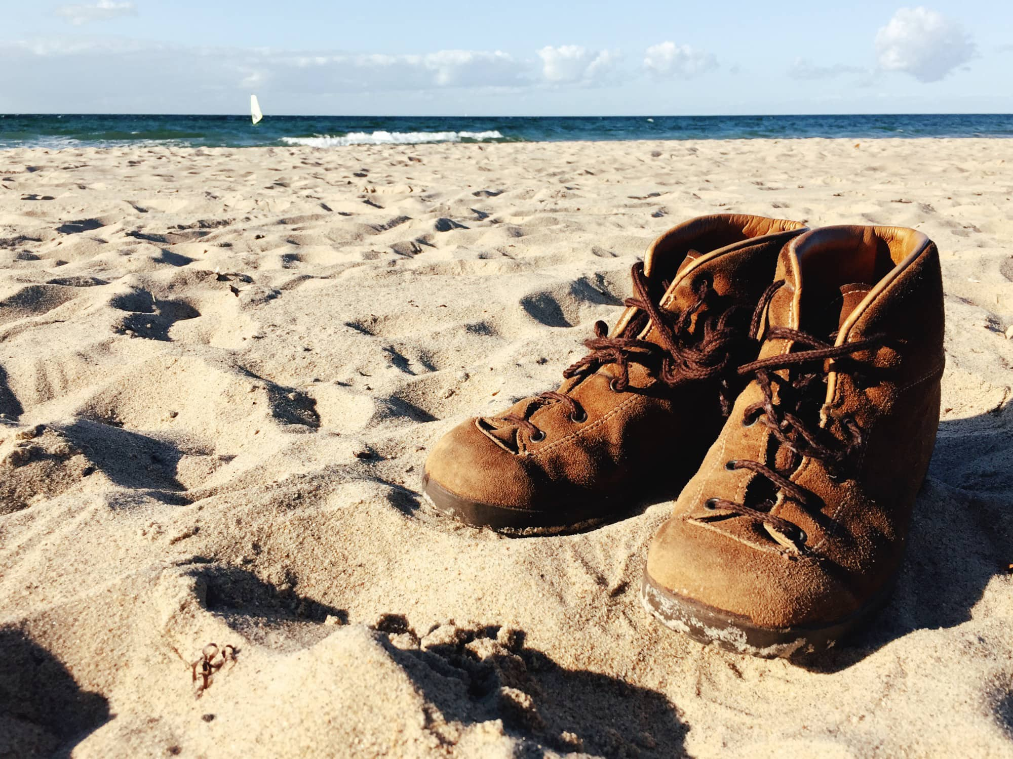 Walking boots on beach